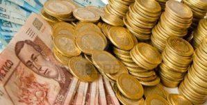 13995508-muchos-pesos-mexicanos-de-dinero-monedas-y-billetes-de-banco